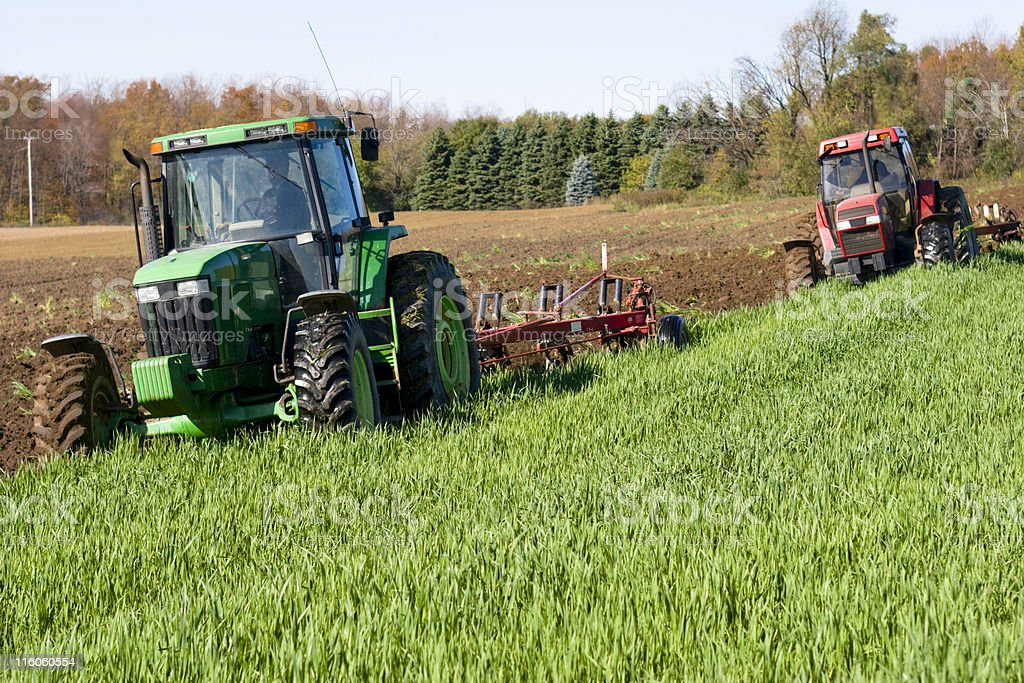 Two Tractors Plowing in Tandem royalty-free stock photo