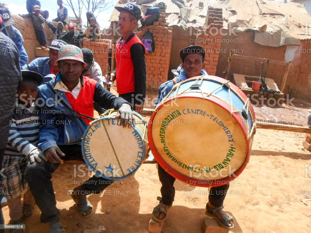 Two traditional Malagasy musicians posing with their drums during the rite of 'famadihana' (exhumation) in the highlands stock photo