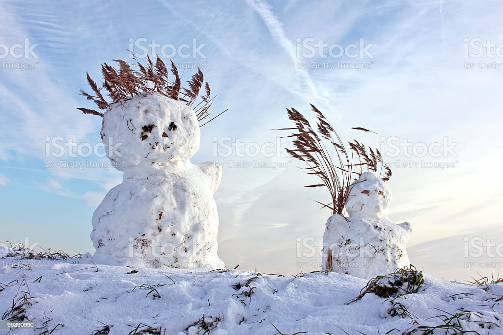 Two traditional snowmen in wintertime the Netherlands - Royalty-free Blue Stock Photo