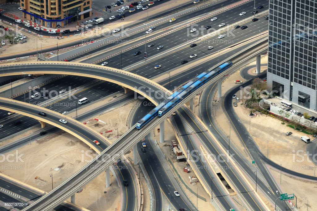 Two trains and road junction from above in Dubai. stock photo