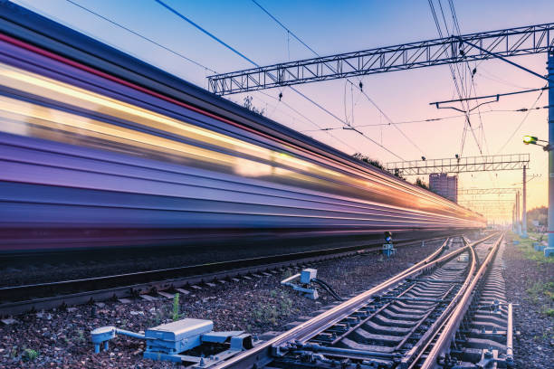 Two trains move fast to the different directions. Two trains move fast to the different directions at sunset time. bullet train stock pictures, royalty-free photos & images