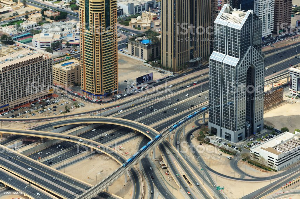 Two trains, road junction and skyscrapers from above in Dubai. stock photo
