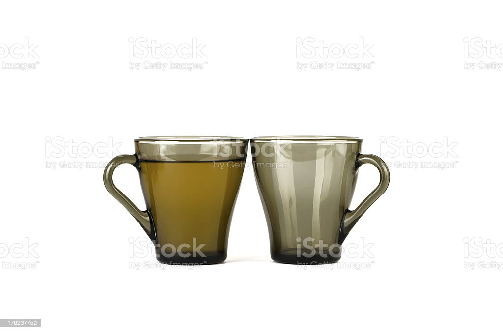 Two transparent cups, one with tea, the second blank stock photo