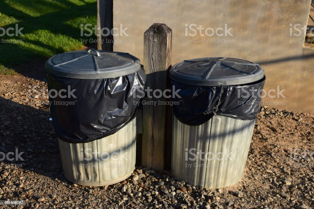 Two trash cans stock photo