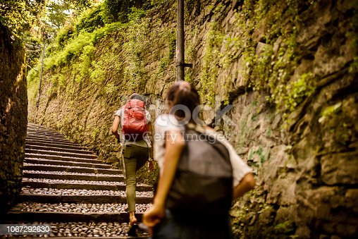 Two Latin friends with back pack traveling