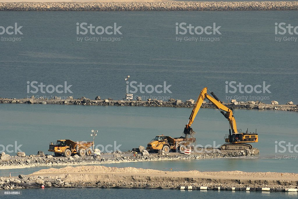 Two trucks and an excavator stock photo
