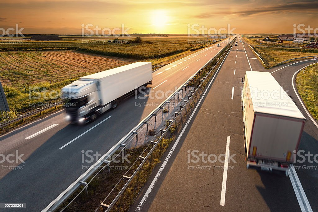 Two trucks on highway in motion blur stock photo