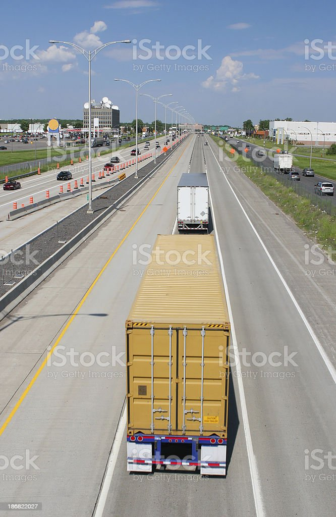 Two trucks on the middle track of the highway royalty-free stock photo