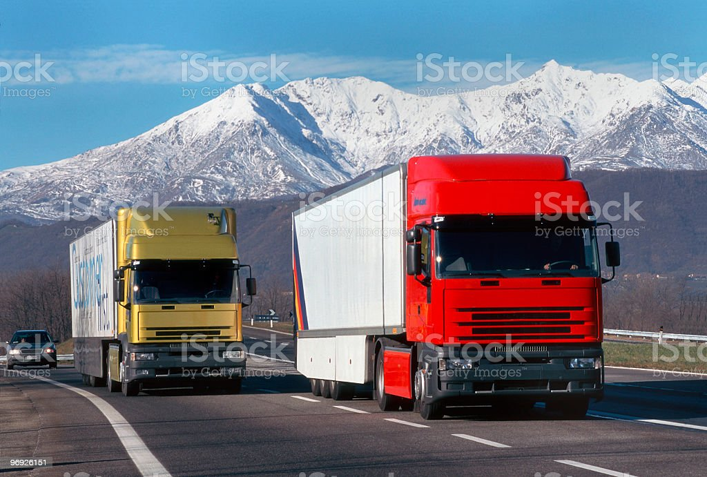 Two trucks on the Motorway with mountains on background royalty-free stock photo