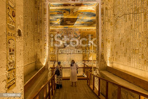 istock Two turists in the interior of a tomb  in the valley of the kings 1075698140
