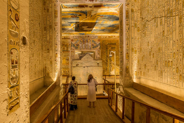 Two turists in the interior of a tomb  in the valley of the kings Two turists in the interior of the tomb KV 2 Ramses IV in the valley of the kings, Luxor, Egypt, October 21, 2018 valley of the kings stock pictures, royalty-free photos & images