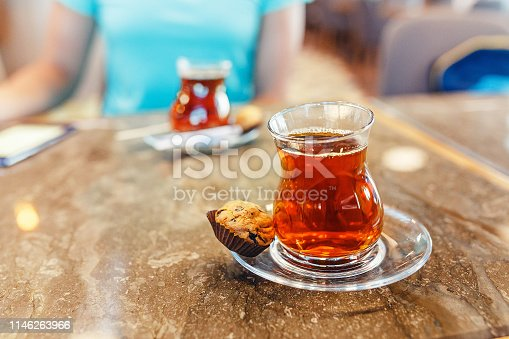 Two turkish tea in traditional glasses on cafe table