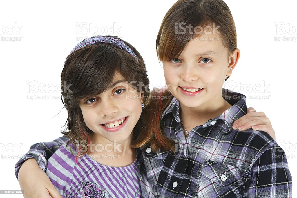 Two Tween aged girls smiling at camera royalty-free stock photo