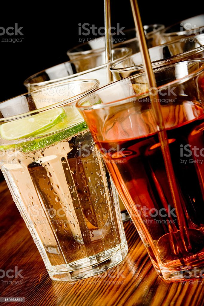 Two types of drinks in multiple cups on a bar royalty-free stock photo