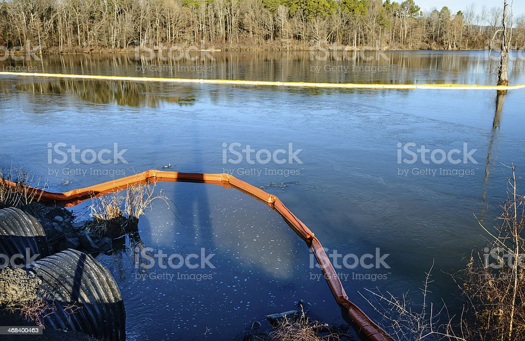 Two types of oil spill booms stock photo