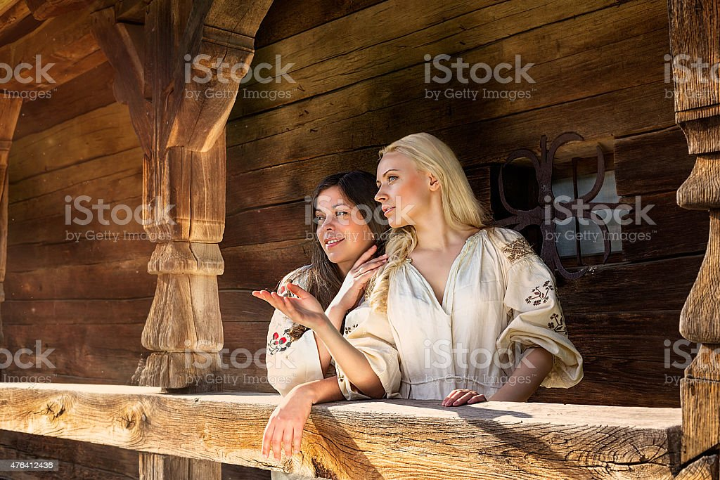 Two ukrainian girls in national costumes at the sun-parlour stock photo
