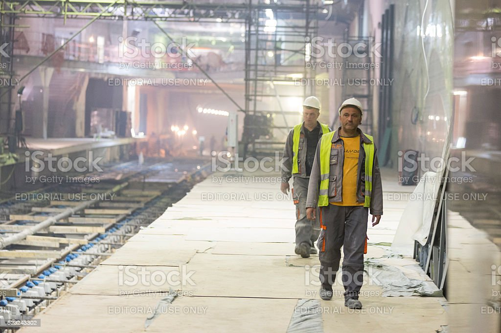 Two underground subway tunnel workers stock photo