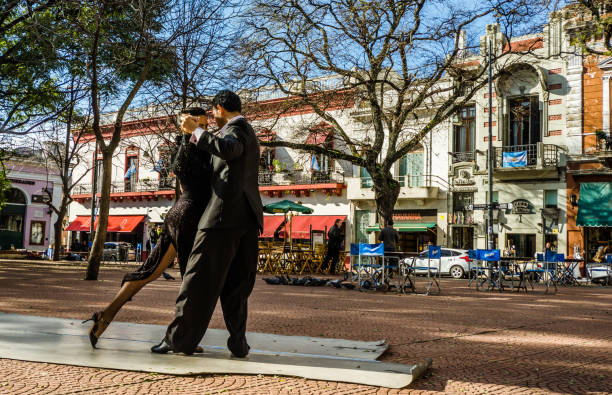 Two unidentified tango dancers Buenos Aires, Argentina - July 11, 2016: Two unidentified tango dancers performing at Plaza Serrano in San Telmo neighborhood, a very touristic place, on a sunny day buenos aires stock pictures, royalty-free photos & images