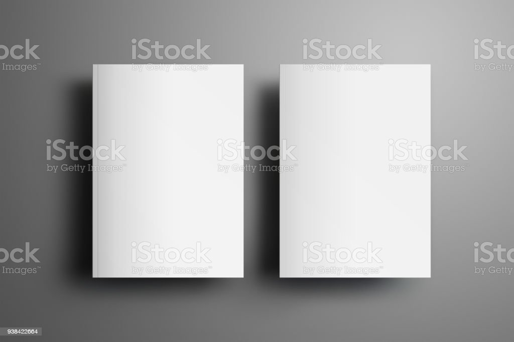 Two universal blank closed A4, (A5) brochures with soft realistic shadows  isolated on gray background. Top of view. stock photo