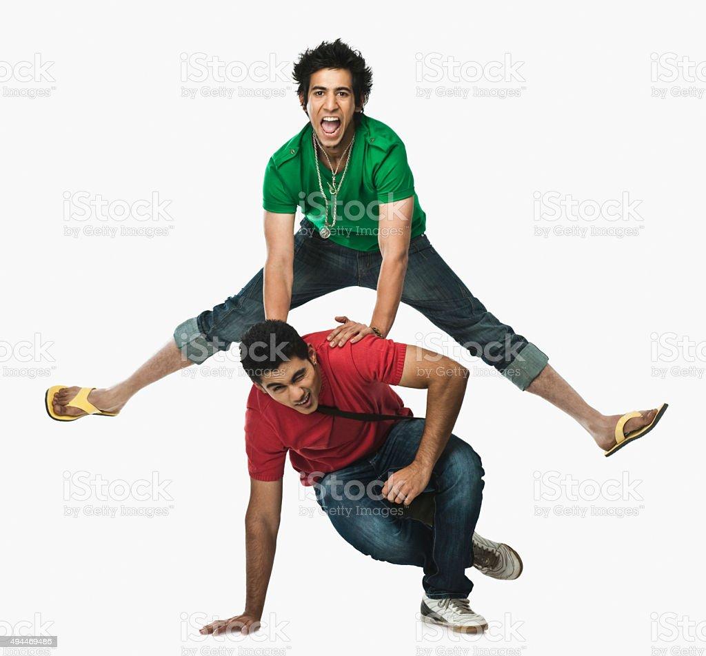 Two university students playing leapfrog stock photo