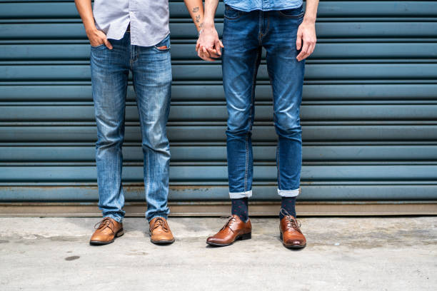 two unrecognizable men holding hands - men shoes stock pictures, royalty-free photos & images