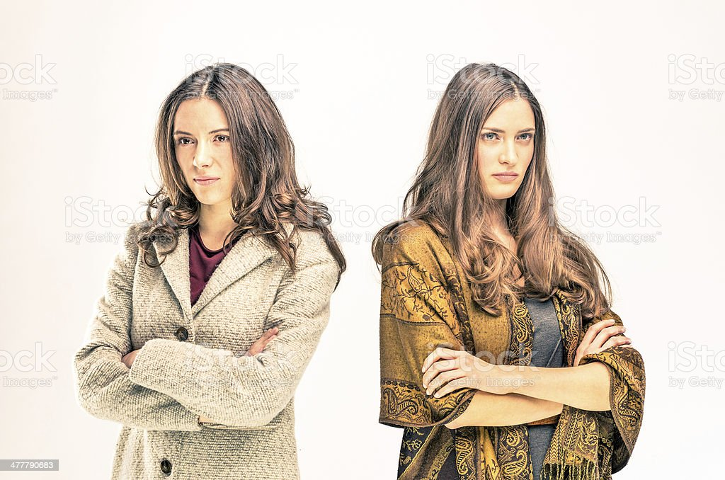 Two upset young women with different opinions stock photo