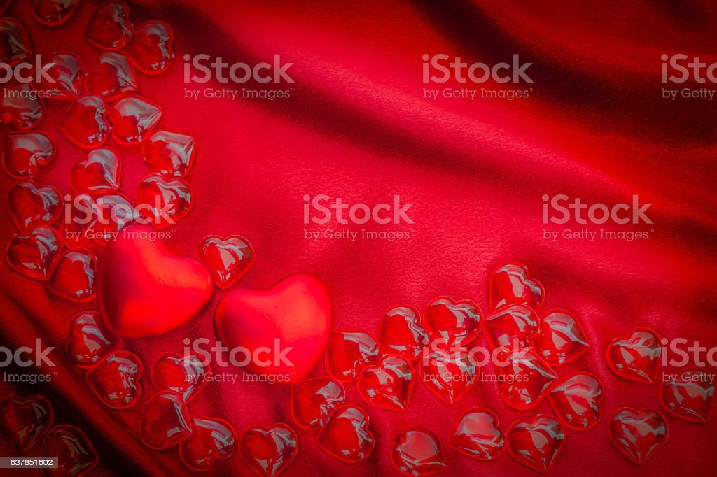 Two Valentine hearts mixed with small ones on red (P) stock photo