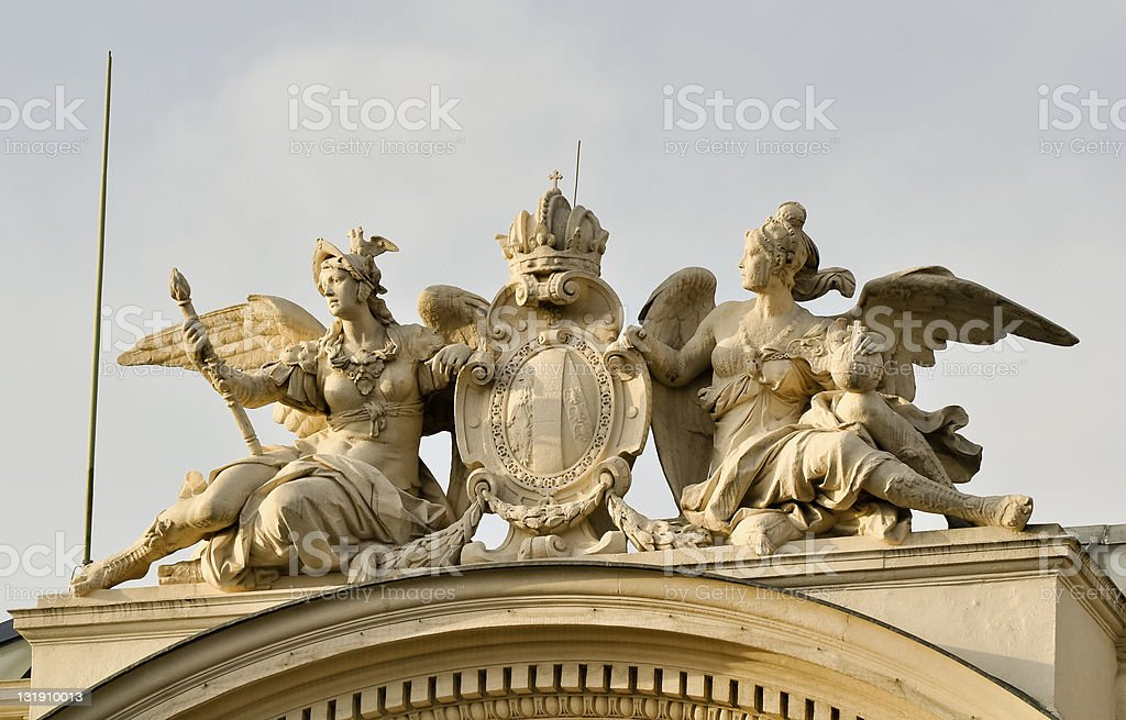 two valkyrs flanking a crest atop historical building stock photo