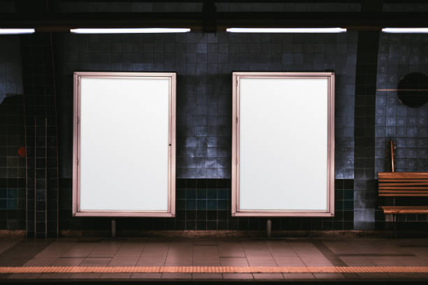 Two vertical posters mockup in metro Two empty ad vertical posters templates on a metro platform; blank information banners placeholders indoors; a subway or a train station with two white billboards in front of a blue tile wall billboard stock pictures, royalty-free photos & images