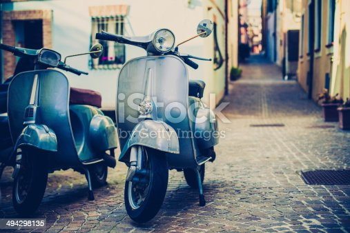 Italian urban scene with a Vespa, a very typical italian motorcycle