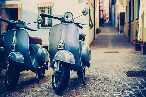 dos vespa scooter in italy - vintage vespa fotografías e imágenes de stock
