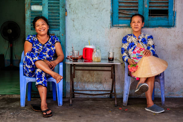 Two Vietnamese women drinking coffee together, Mekong River Delta, Vietnam Two Vietnamese women drinking coffee together, Mekong River Delta, Vietnam vietnamese ethnicity stock pictures, royalty-free photos & images