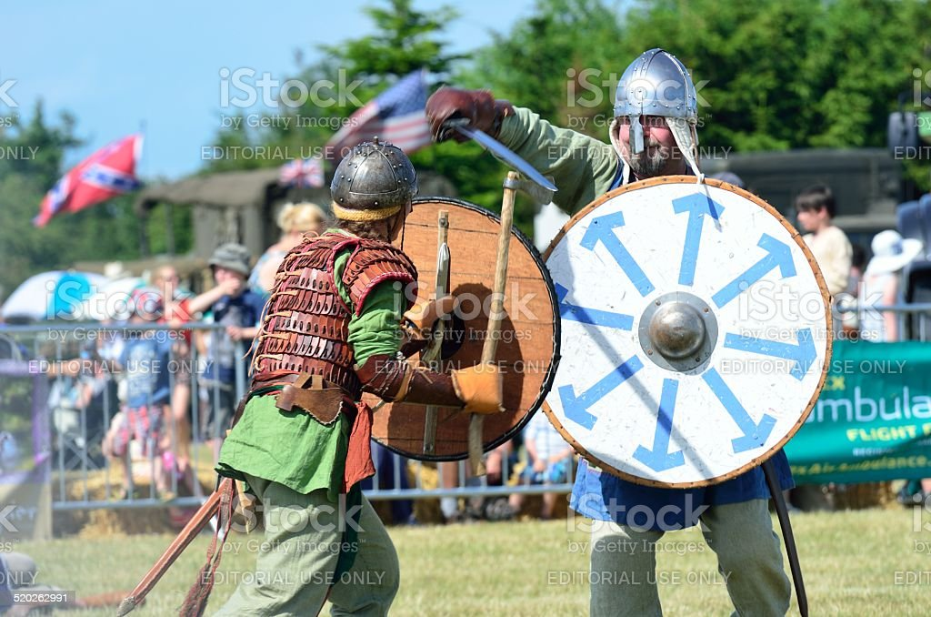 Two Vikings fighting with sword and shields stock photo