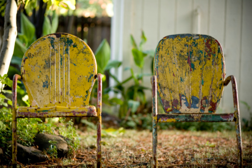 two vintage 50's metal chairs in autumn