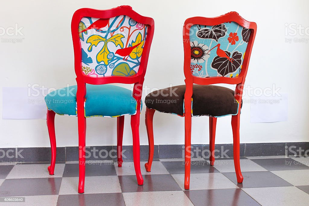 Two Vintage Chairs in Red and Orange stock photo