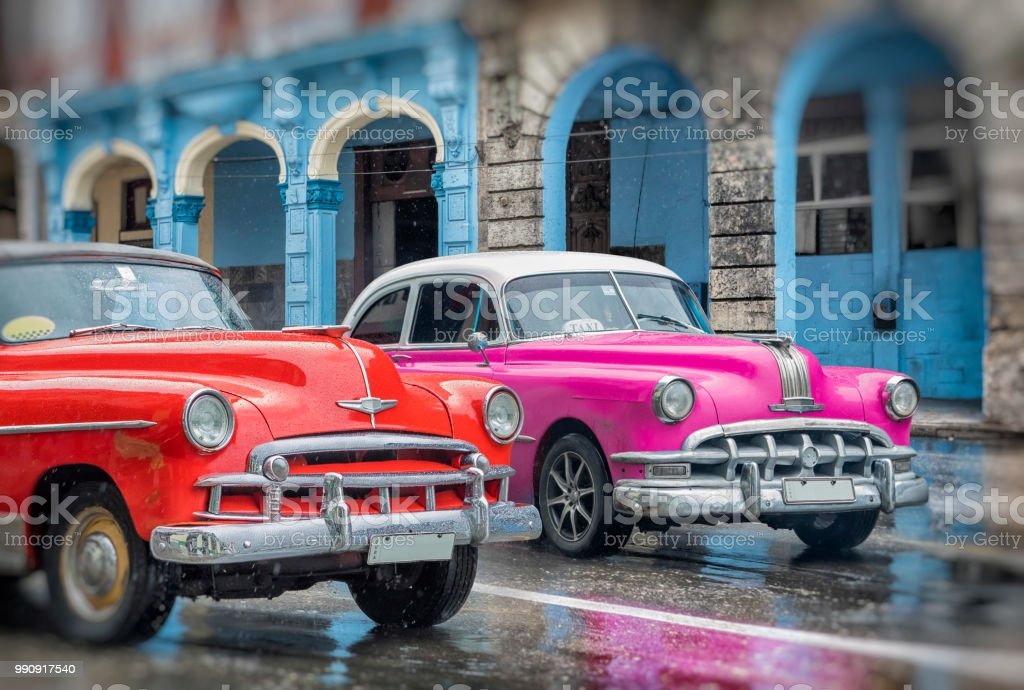Two vintage classic american oldtimer cars in old town of Havana Cuba...