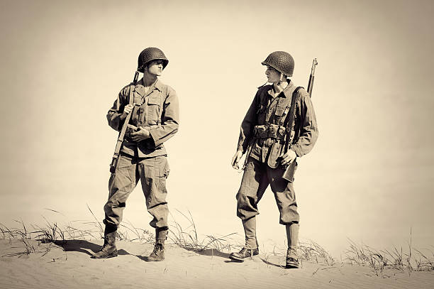 two vintage wwii soldiers - world war ii stock photos and pictures