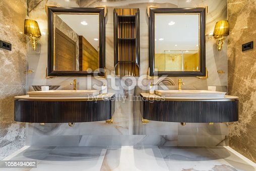 istock Two washbasins with lightening and mirrors in bathroom 1058494062