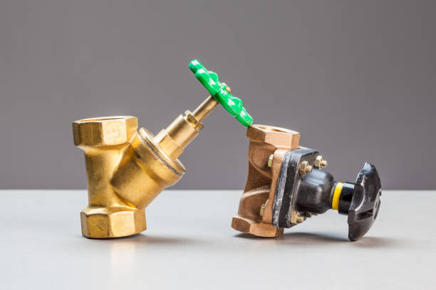 two water valves on a table, there are two water valveson a table, there are two water valves verbinding stock pictures, royalty-free photos & images