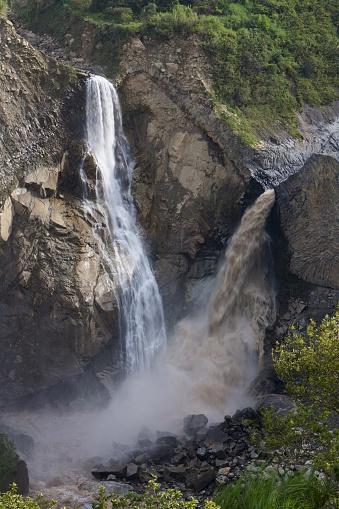 1131408581 istock photo Two waterfalls merge together 618510410