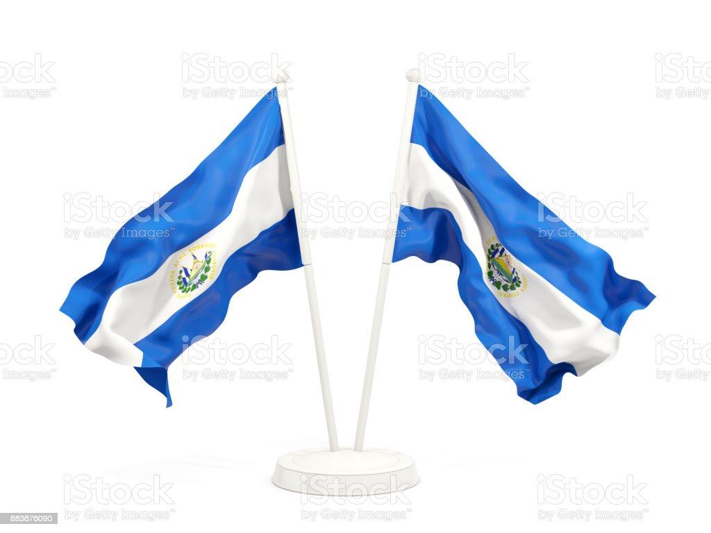 Dos agitando banderas de el salvador - foto de stock