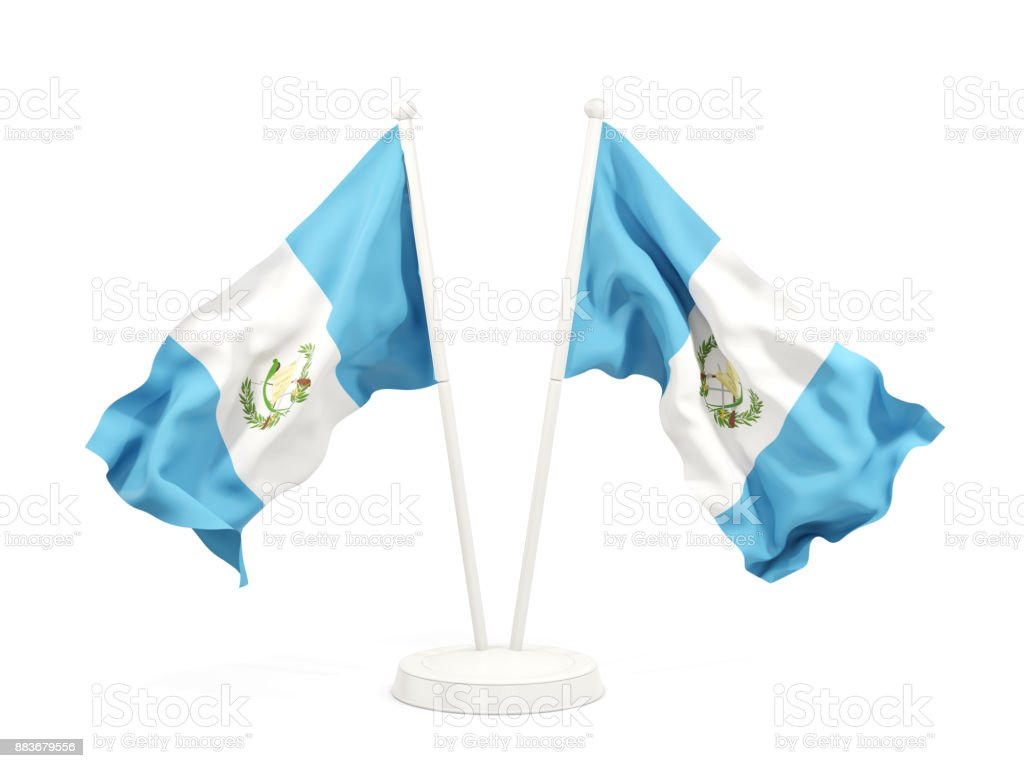 Two waving flags of guatemala stock photo