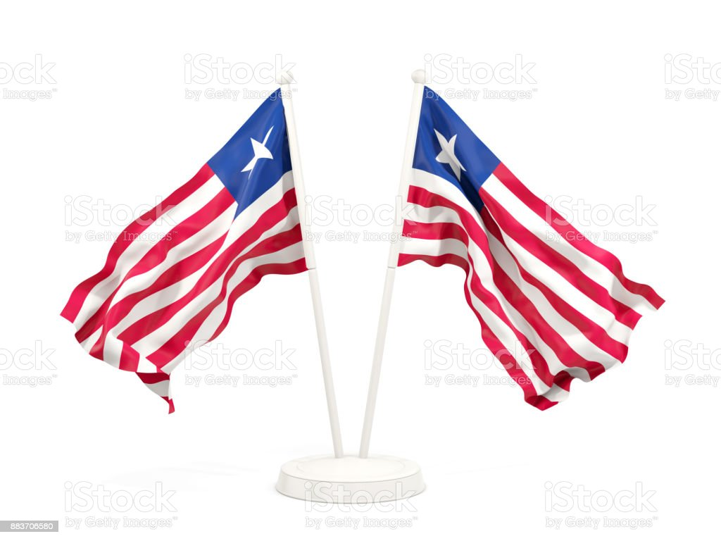 Two waving flags of liberia stock photo