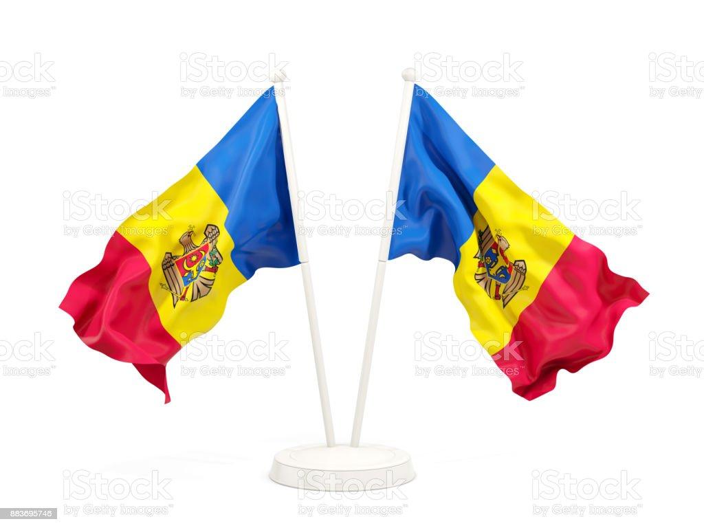 Two waving flags of moldova stock photo