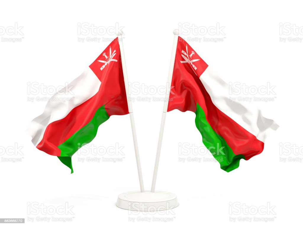 Two waving flags of oman stock photo