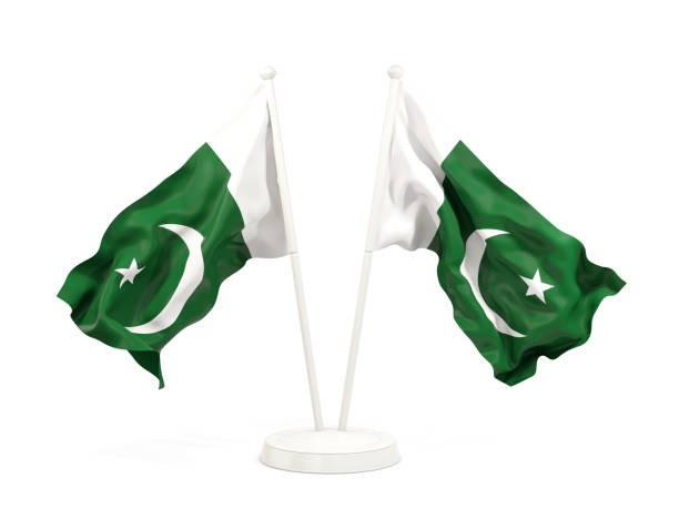 two waving flags of pakistan - pakistani flag stock photos and pictures