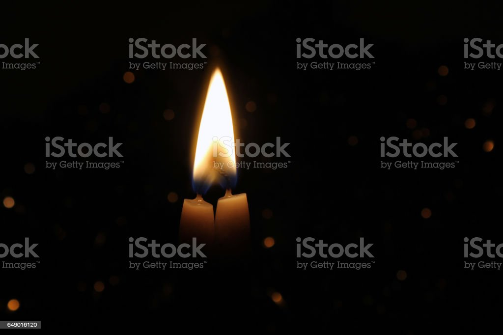 Two wax Candles Burning at Night. stock photo
