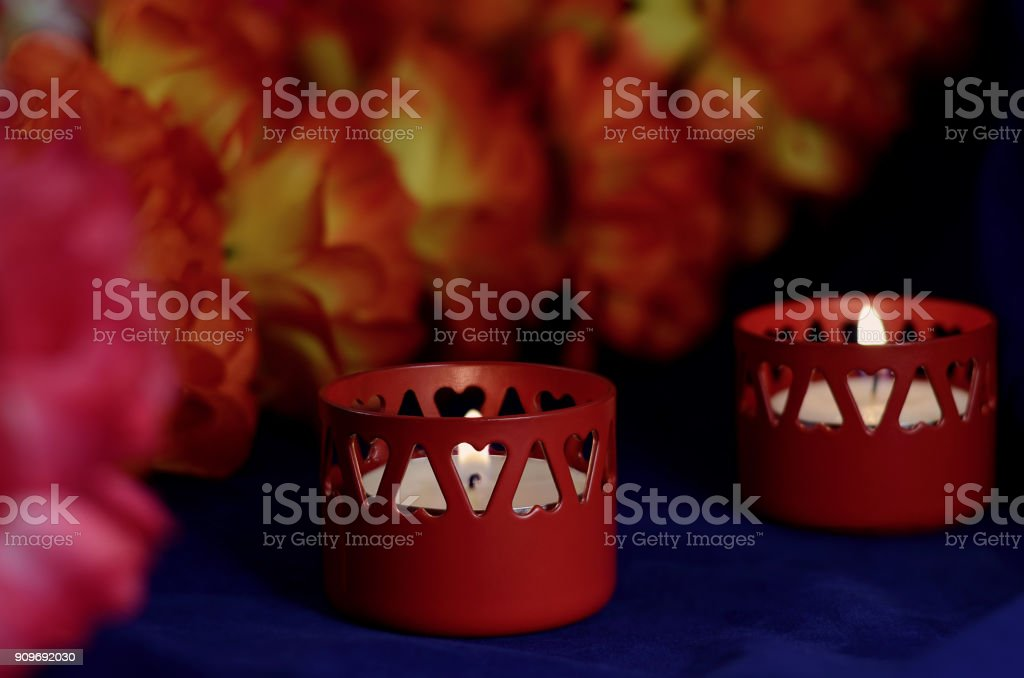 two wax candles stand stock photo