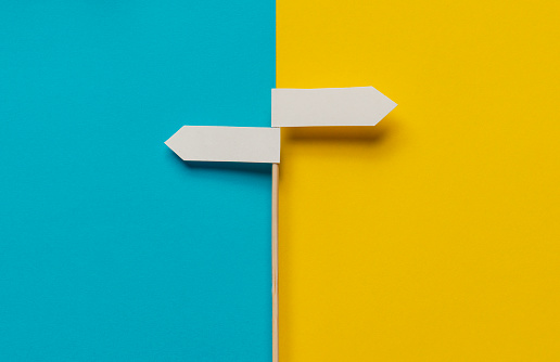 Two directional sign on the two color background.