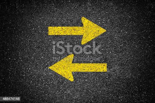Arrow signs on the asphalt
